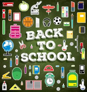 Back to school. School supplies on green chalk board background.