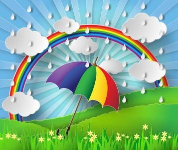 Colorful umbrella in the rain with rainbow