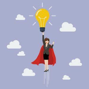 Business woman superhero holding creative lightbulb