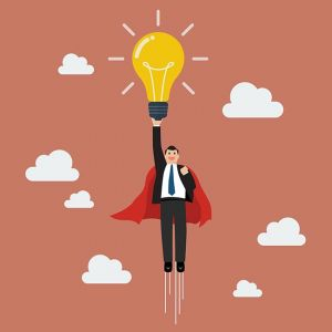 Businessman superhero holding creative lightbulb