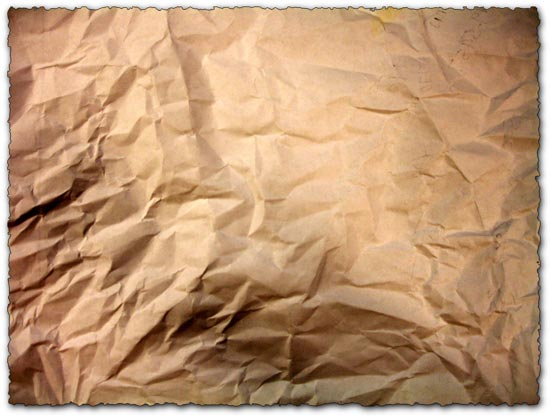 Closeup of old crumpled brown paper texture